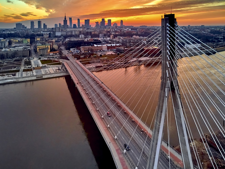 Beautiful panoramic aerial drone sunset view to Warsaw city center with skyscrapers and Swietokrzyski Bridge (En: Holy Cross Bridge) - is a cable-stayed bridge over the Vistula river in Warsaw, Poland 版權商用圖片