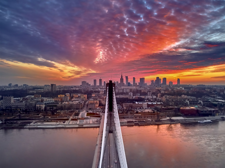 Beautiful panoramic aerial drone sunset view to Warsaw city center with skyscrapers and Swietokrzyski Bridge (En: Holy Cross Bridge) - is a cable-stayed bridge over the Vistula river in Warsaw, Poland Reklamní fotografie