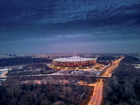 Beautiful panoramic aerial drone sunset view to The PGE Narodowy (official name) of National Stadium - Polish: Stadion Narodowy - football stadium located in Warsaw, Poland