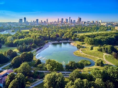 A beautiful panoramic view of the sunset in a fabulous evening in June from drone at Pola Mokotowskie in Warsaw, Poland - Mokotow Field is a large park in Warsaw - Is called Jozef Pilsudski Park