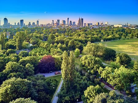 A beautiful panoramic view of the sunset in a fabulous evening in June from drone at Pola Mokotowskie in Warsaw, Poland -