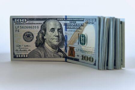 Stack of one hundred dollar bills new design on a white background Zdjęcie Seryjne - 125166118