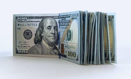 Stack of one hundred dollar bills new design on a white background Zdjęcie Seryjne - 125166121