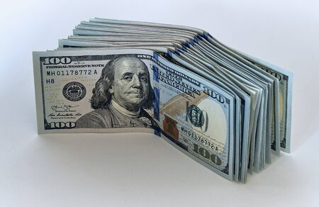 Stack of one hundred dollar bills new design on a white background