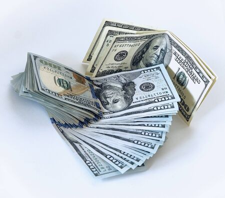 Stack of one hundred dollar bills new design on a white background