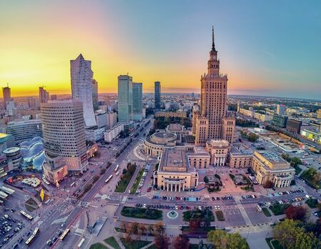 Beautiful panoramic aerial drone view at sunset to the center of Warsaw City and Palace of Culture and Science - a notable high-rise building in Warsaw, Poland Banco de Imagens