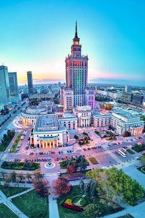 Beautiful panoramic aerial drone view at sunset to the center of Warsaw City and Palace of Culture and Science - a notable high-rise building in Warsaw, Poland