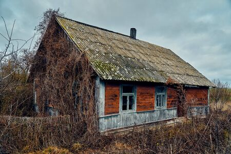 A terrible mysterious apocalyptic view: an abandoned house in the abandoned Belarusian Kovali (Belarusian: blacksmiths) village - no one lives here anymore