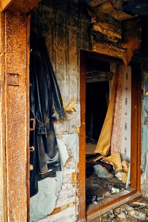 A terrible mysterious apocalyptic view: an abandoned house in the abandoned Belarusian Kovali (Belarusian: blacksmiths) village - no one lives here anymore - interior: scattered things