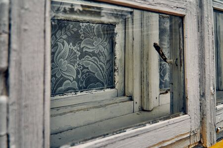 old wooden window frames - a terrible mysterious apocalyptic view: an abandoned house in the abandoned Belarusian Kovali (Belarusian: blacksmiths) village - no one lives here anymore