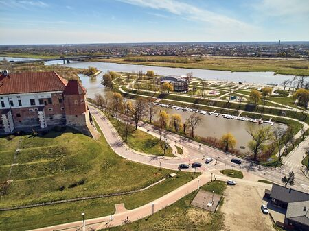 Beautiful panoramic aerial drone view to the Sandomierz Royal Castle - planting vines in the vineyard of St. Jakub - near the monastery and Church of St. Jakub in Sandomierz City, Poland