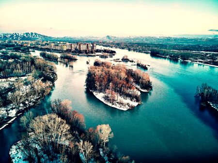 Panoramic aerial view: beautiful spring landscape: the Irtysh river in Kazakhstan wakes up from winter sleep - ice drift - snow and ice are melting at sunset, Qazaqstan Zdjęcie Seryjne