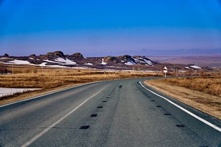 Panoramic view: beautiful spring landscape: spring huge great steppe wakes up from winter sleep - snow and ice just melted, sunset, Kazakhstan (Qazaqstan) Zdjęcie Seryjne
