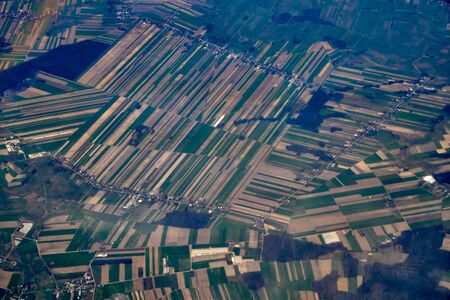 Beautiful panoramic aerial landscape - top view of the Vistula river and fields - view from the window of the plane landing at the Warsaw (Poland) at spring at sunset Zdjęcie Seryjne