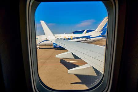 NUR-SULTAN (ASTANA), KAZAKHSTAN (QAZAQSTAN) - APRIL 12, 2020: Beautiful panoramic view from the airplane window at the airport of Nur-Sultan (Astana)
