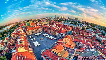 Beautiful panoramic aerial drone view on Warsaw Old town (POL: Stare Miasto) with modern skyscrapers on the horizon, square and the Column of Sigismund III Vasa at sunset, Poland.