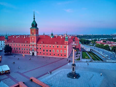 Beautiful panoramic aerial drone view on Warsaw Old town (Stare Miasto) - the oldest district of Warsaw (13th century), square and the Column of Sigismund III Vasa at sunset, Poland