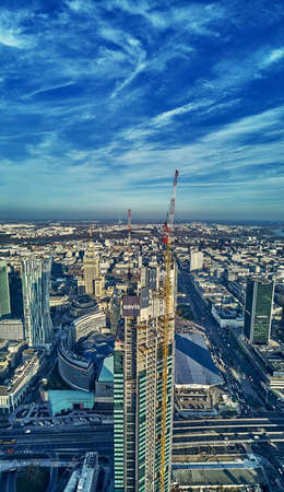 WARSAW, POLAND - NOVEMBER 19, 2020: Beautiful panoramic aerial drone view on Warsaw City Skyscrapers, PKiN, and Varso Tower (the tallest skyscraper in the European Union) under construction, EU