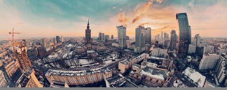 Beautiful panoramic aerial drone view on All Saints Church - Roman Catholic church located at Grzybowski Square, Warsaw City Skyscrapers, PKiN, and Varso Tower under construction. Warsaw, Poland.