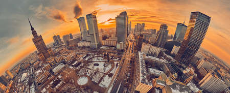 Beautiful panoramic aerial drone view on Warsaw City Skyscrapers, PKiN, and Varso Tower (the tallest skyscraper in the European Union) under construction during the January sunset. Warsaw, Poland.