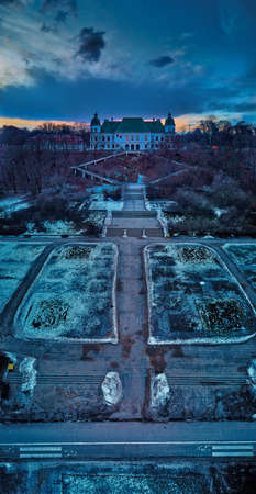Beautiful panoramic aerial drone view on the Center of Contemporary Art in the Ujazdowski Castle along with a beautiful baroque park during the sunset, Warsaw, Poland.