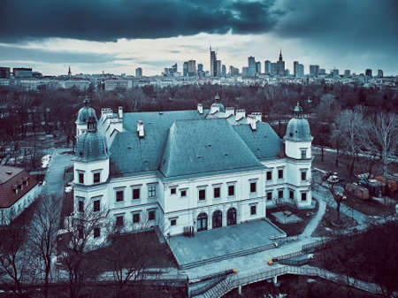 Beautiful panoramic aerial drone view on the Center of Contemporary Art in the Ujazdowski Castle against the Warsaw City Skyscrapers, PKiN, and Varso Tower during the sunset, Warsaw, Poland.