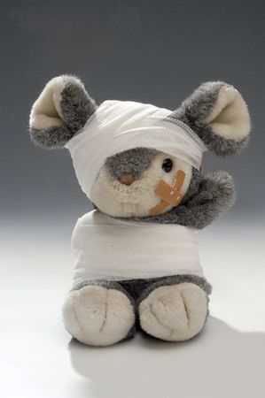 toy mouse with plaster and bandage              Stock Photo