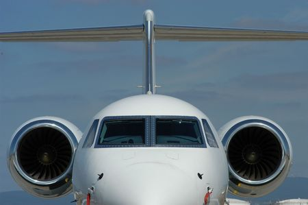 Two engine business jet on a parking position.