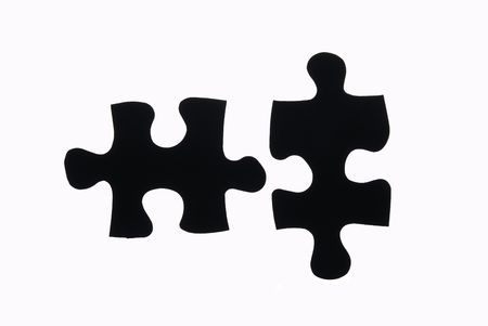 two pieces of a puzzle isolated on white.