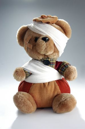 Teddy bear with bandage and plaster.