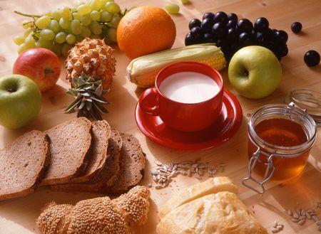 fresh morning: healthy food,dark bred,honey and fresh fruits.