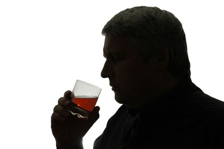 Man with glass whiskey  in his hand, drinking.