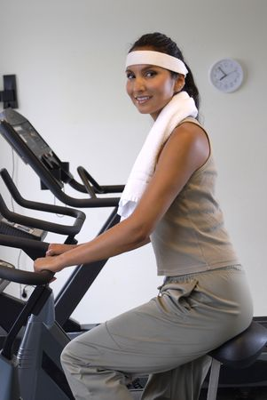 young woman at the gym, exercising.Wearing sporting outfit. Stock Photo