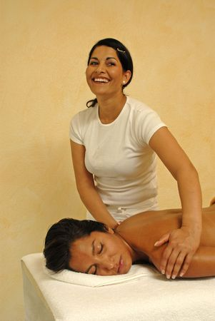 young woman getting massage therapy.Masseur and client smiling. Stock Photo - 3592973