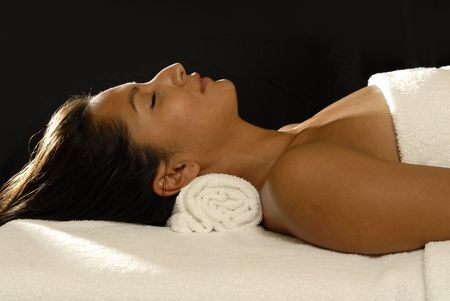 Young woman relaxing,lying on a  table.Spa area. Stock Photo