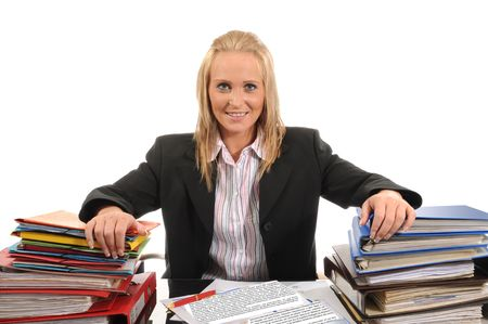 young woman doing her paperwork at the office. Stock Photo