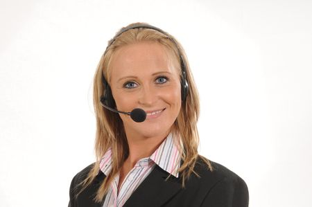 young woman at the callcenter, using a headset. Stock Photo
