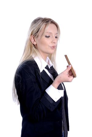 Young business woman is smoking a cigar