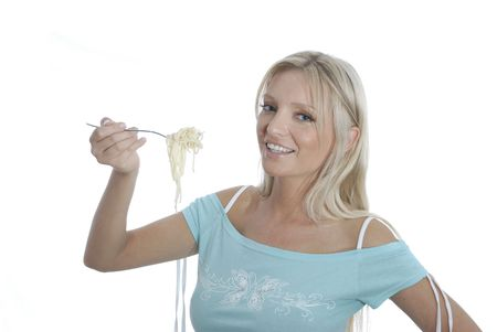 Young woman is enjoying a fork with spaghetti.