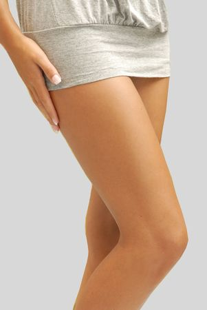 Legs of a young and attractive woman with nice suntan. Stock Photo