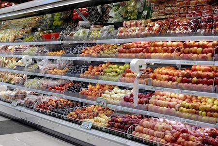 Supermarket shelf with lots of fresh fruits.