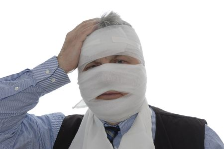 Man`s head being bandaged due to accident.