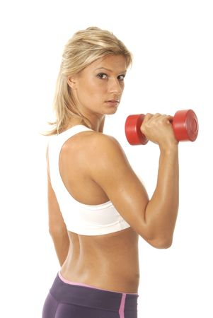 Young woman lifting red dumbbell.