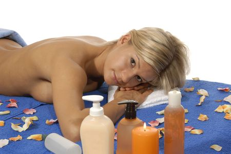 Young woman lying on a  table,enjoying a aroma therapy.