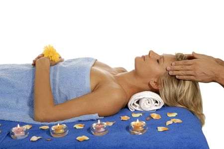 Young woman lying on a massage table,enjoying a aroma therapy. Stock Photo