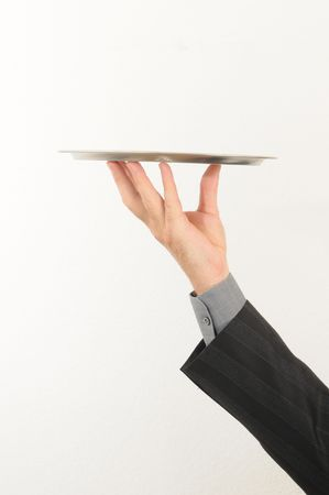 Man holding a silver tray on his hand, isolated over white. Stock Photo