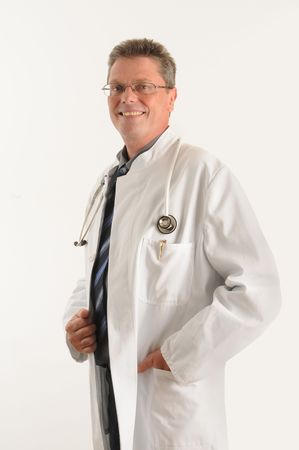 Doctor at the clinic, seems to be confident, smiling.Isolated over white.