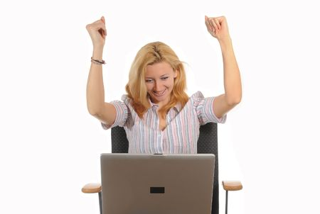hurray: Young woman sitting on a office chair working with her laptop. Happy due to success.