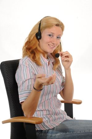 Young woman with headset, sitting in a office chair.Isolated over white. Stock Photo