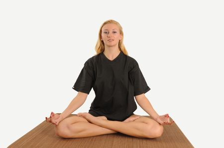 young woman concentrating on yoga exercise,isolated.